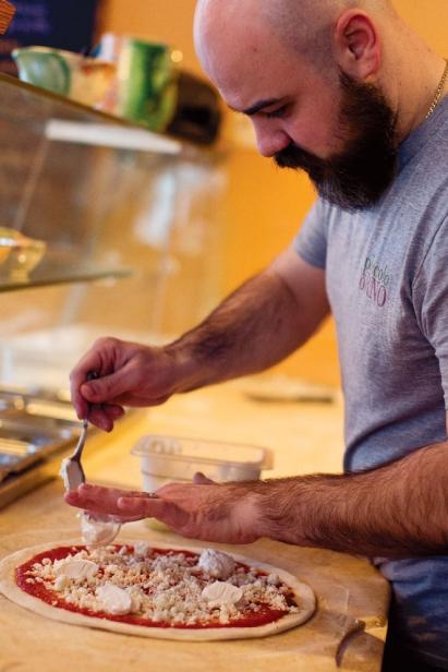 Chef Domenic Branduzzi making pizza